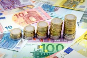 Increasing stacks of euro coins on euro banknotes